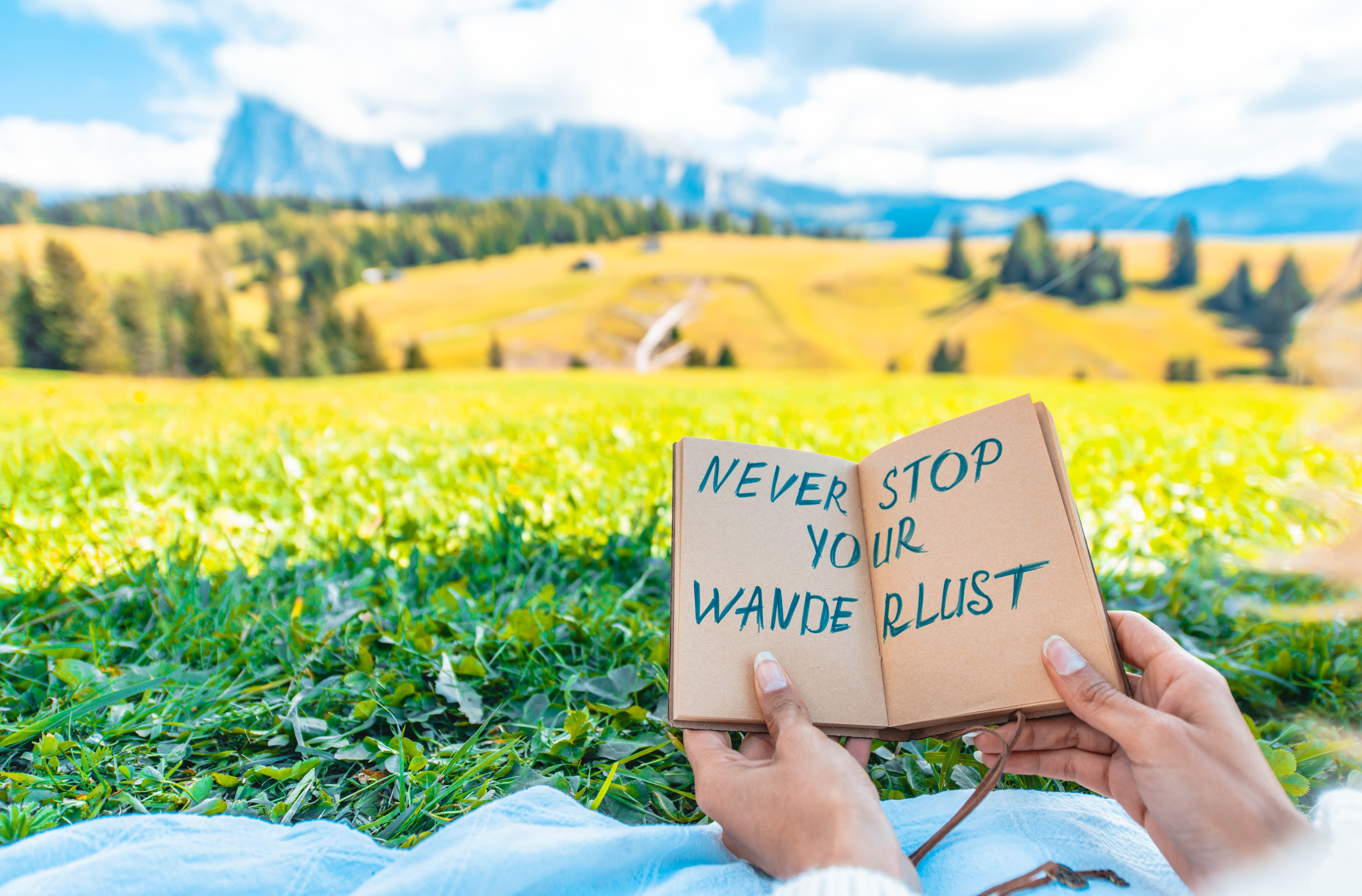 woman-holding-message-about-travelling-and-wanderl-EDDDXF3-1
